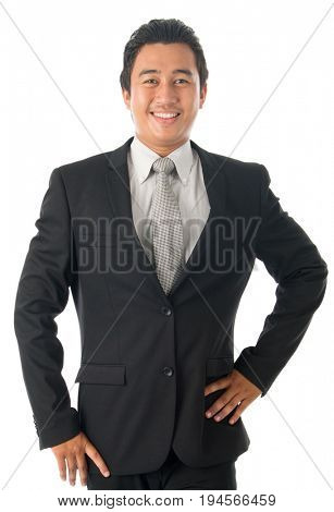 Portrait of happy young Southeast Asian businessman standing isolated on white background.