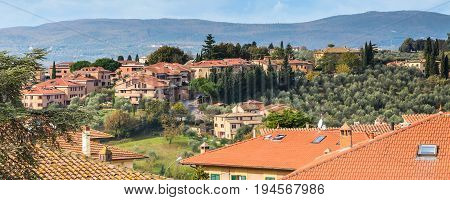 Cityscape skyline panorama banner of old town Siena, Tuscany, Italy with houses, cypresses