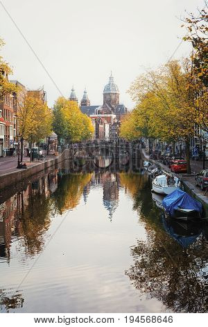 Amsterdam, Netherlands - October 30 2016: The canal Oudezijds Voorburgwal in the Red light District of the old center of Amsterdam