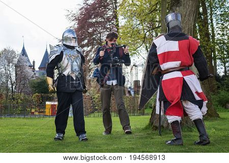 Haarzuilens, Netherlands - April 24 2016: Knight fight filmed by a cameraman during The Elf Fantasy Fair (Elfia) an outdoor fantasy event in the Netherlands.