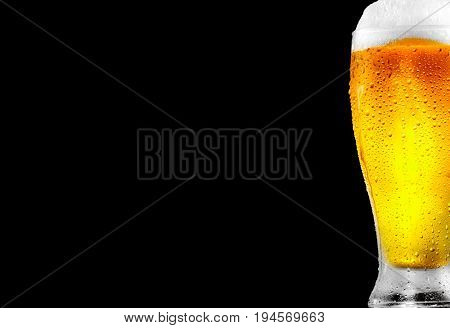 Beer. Cold Craft light Beer in a glass with water drops. Craft Beer close up isolated on black background. Border menu design