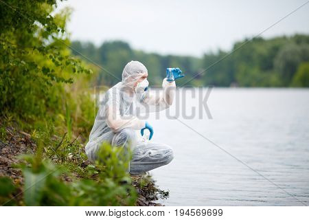 Ecologist with bulb on river