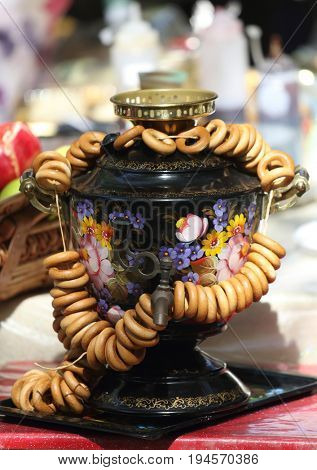 Russian painted samovar and a bagel at a festival in Jerusalem