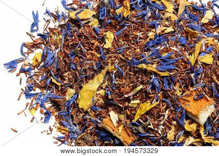 Rooibos tea with cornflower and orange slices on white background. Top view. Close up. High resolution