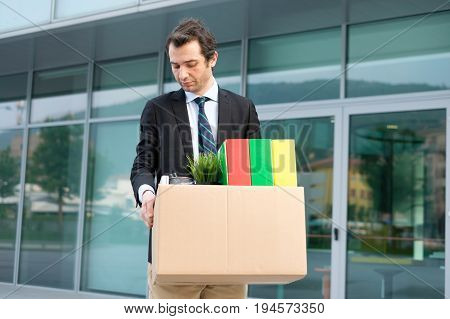 Desperate And Fired Businessman Walking Away From Office