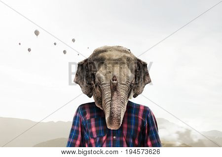 Elephant dressed in checked shirt. Mixed media