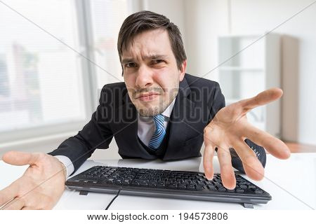 Frustrated Confused And Unsure Man Is Working With Computer In O