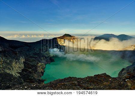 Beautiful Landscape Mountain And Green Lake With Smoke Sulfur In Kawah Ijen Volcano Indonesia