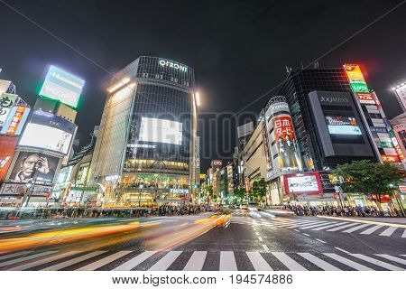 Tokyo, Japan. May 30, 2015. The shibuya district in Tokyo with blurred traffic. Shibuya is popular in Tokyo for his pedestrian cross where pedestrians cross in the same moment from all directions.