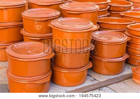 Traditional spanish cooking pots at the tourist market on the Plaza de la Reina in Valencia Spain