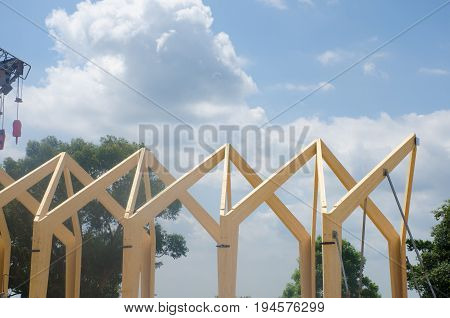 Wooden frame of commercial construction ready for roof