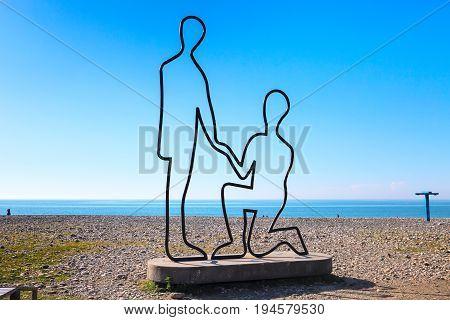 Batumi, Georgia - April 30, 2017: Scuplture of man and woman in love on the beach along the Black Sea in Batumi, Adjara, Georgia.