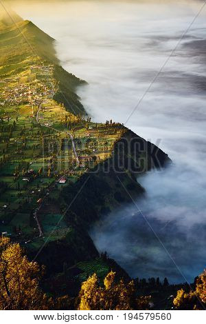 Attractive Cemoro Lawang Village And Mist During Morning Time While Rays Of Sunlight Shines, Indones