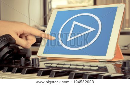 Music and Video Play button on tablet in Music studio