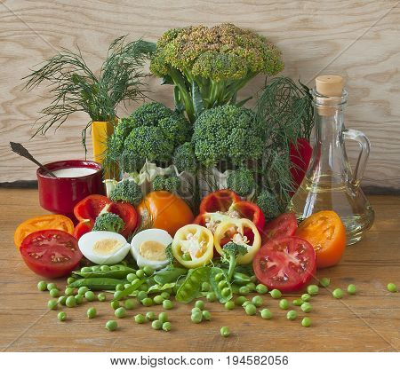 A set of vegetables eggs greens and currants for cooking a vegetarian dish.