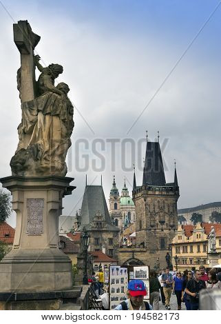 PRAGUE CZECH REPUBLIC - SEPTEMBER 15 2014: tourists walk on Charles Bridge Prague the Czech Republic