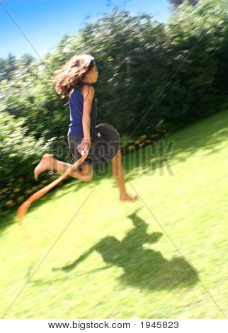 0 Girl Skipping Fast On Her Rope Across Field