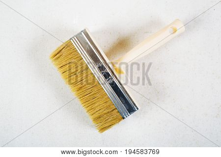 Brush for glue for wall-paper on white background