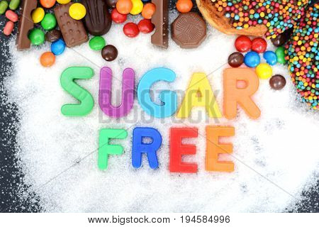 Sugar free text with multicolored letters on sugar background