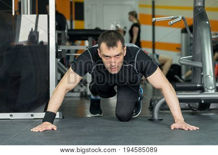 Fitness Man Doing Push-ups Exercise Intense Training In Gym.