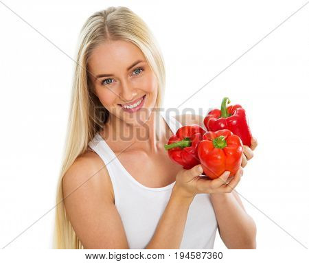 Young woman with peppers