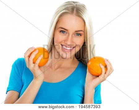 Smiling pretty woman with oranges