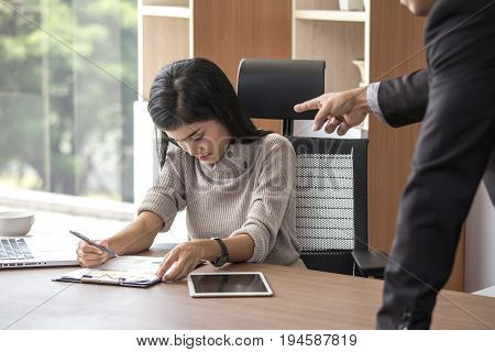 Asian woman working with stress situation boss blame her for mistake at office place 20-30 year old.