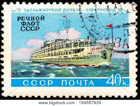 UKRAINE - CIRCA 2017: A postage stamp printed in USSR shows ship and Inscription Passenger Diesel-electric River Fleet of USSR from the series Domestic fleet circa 1960