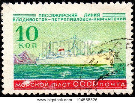 UKRAINE - CIRCA 2017: A postage stamp printed in USSR shows Soviet Liners Ship and Inscription Soviet Navy Passage line Vladivostok - Petropavlovsk-Kamchatsky from the series Ships circa 1959