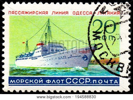 UKRAINE - CIRCA 2017: A postage stamp printed in USSR shows Soviet Liners Ship and Inscription Soviet Navy Passage line Odessa - Latakia from the series Ships circa 1959