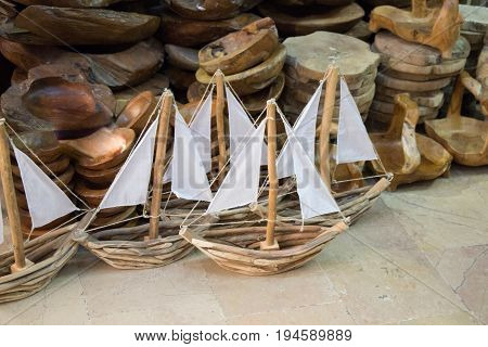 Set of hand made sail boats in view