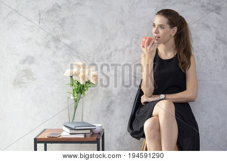 Beautiful Young Woman Using Smartphone While Eating Apple, 20S Year Old.