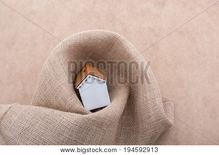 Model House Wrapped In A Linen Canvas