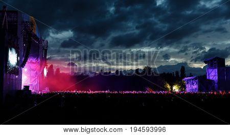 Spectators At A Concert At Night