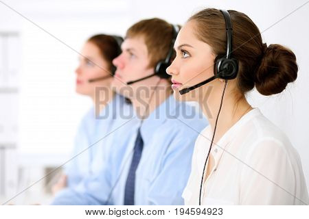 Call center operators. Young beautiful business woman in headset