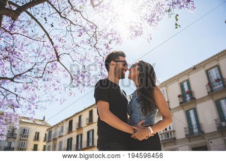 Happy Couple Embracing Looking At Each Other In Sun Light