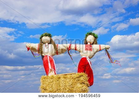 Closeup scarecrow in countryside of Ukraine. Scarecrow against the sky