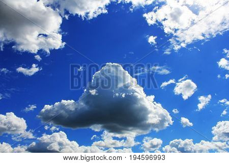 White clouds in blue sky. Blue sky background.