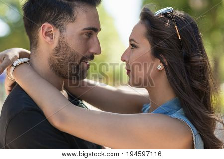 Young Couple In Love Looking At Each Other Eyes