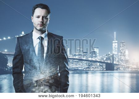 Portrait of thoughtful handsome businessman on night city background with copy space. Tomorrow concept. Double exposure