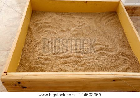 Sandbox made homemade with wood. Horizontal shot With natural light