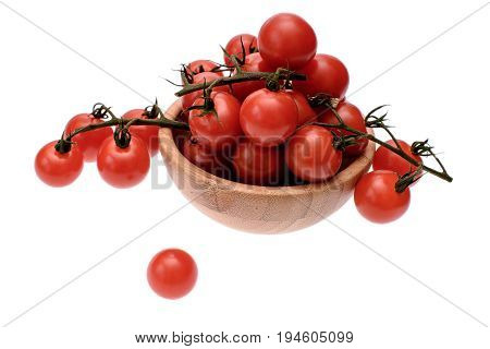 Red Cherry Tomatoes Lie In A Wooden Cup, Isolated On A White Background