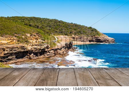 Empty Wooden Table In Front Of Australian Rock Formation With Ocean In Background, Sandstone Texture
