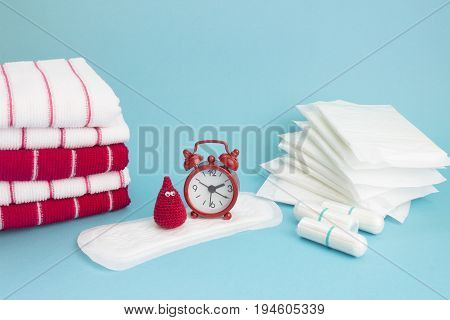 Funny crochet blood drop red clock terry towels daily and menatrual pad tampon. Menstruation sanitary woman hygiene. Woman critical days gynecological menstruation cycle. Medical conception photo