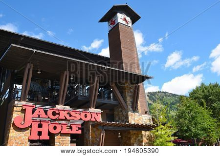 JACKSON HOLE, WYOMING - JUNE 27, 2017: Clock Tower and Tram Station. The 100-foot tall clock tower at the Valley Station of the two and one-half mile, 63-passenger aerial tram.