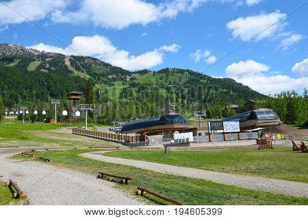 JACKSON HOLE, WYOMING - JUNE 27, 2017: Teewinot Chairlift and Sweetwater Gondola at Teton Village, Jackson Hole, Wyoming.