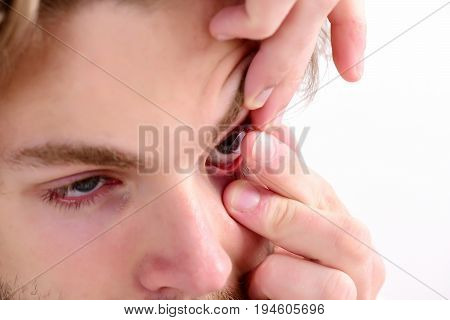 Guy Holds Corrective Lense On His Finger Isolated On White
