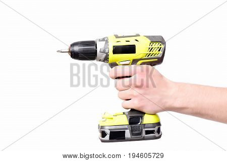 Tool for drilling in yellow color held in males hand. Building instrument isolated on white background. Construction and repairing concept