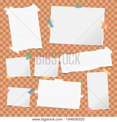 White note, notebook, copybook paper strips stuck with colorful sticky tape on orange squared background