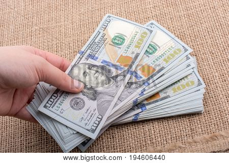 Hand Holding Bundle Of Us Dollar In Hand